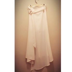 Long white Bebe skirt with size slit NWOT